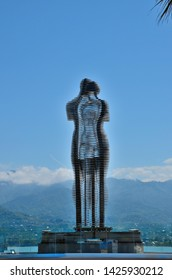 Batumi, Georgia - May 16, 2018: The intertwining moving mechanical art installation statue depicting two lovers - Ali and Nino - with mountains and the Black Sea in background.