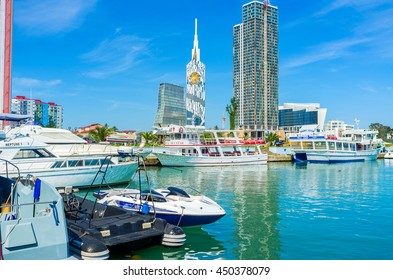 BATUMI, GEORGIA - MAY 25, 2016: The moored in port pleasure boats wait for the tourists, on May 25 in Batumi.