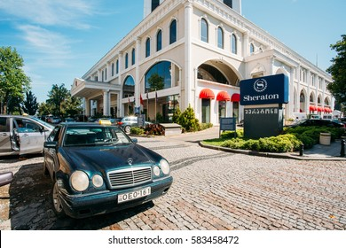 Batumi, Georgia - May 25, 2016: Mercedes Benz Taxi Car Among Parked Automobiles Near Sheraton Batumi Hotel In Sunny Summer Day