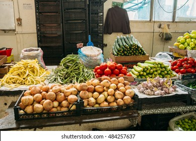 Batumi, Georgia - May 28, 2016: The Counter With Agricultural Produced: Onion, Beans, Tomatoes, Zucchini, Garlic For Sale At The Covered Market Bazar.