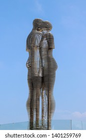 Batumi, Georgia  - May 3, 2018: Moving metal sculpture titled Man and Woman or Ali and Nino against blue sky