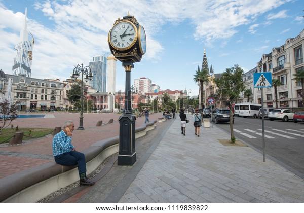 BATUMI, GEORGIA - NOVEMBER 10 2016: Unidentified Georgian man talks on phone at new city square in Batumi, Georgia. Batumi is an important tourist and financial center in the Black Sea region.