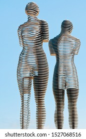 """Batumi, Georgio - August 26 2019: The moving metal love monument """"Ali&Nino"""" in Batumi. Figures are moving towards each other merging into a single entity, without touching."""