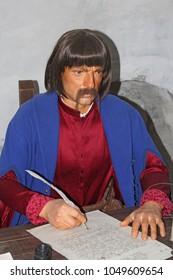 Baturyn / Ukraine. 22 July 2017: Wax figure of old clerk in museum of Baturin. Historical Character. Portrait of clerk with pen in his hand. 22 July 2017 in Baturyn town in Chernihiv region / Ukraine.