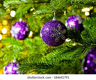 Bauble Ornament in a real Christmas tree in bright color