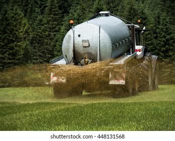 bauer fertilizes a field with manure