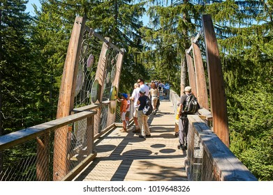 Baumwipfelpfad Treetop walkway in Bavarian Forest near Neuschonau, Germany - August 28, 2011: Tourists walking on treetop walkway experience the boundless forest wilderness of the Bavarian Forest