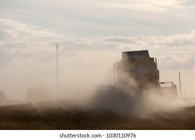 Bauska, Latvia - 2015/22/08: 450 Class Tucano combine working on a field in Bauska, Latvia