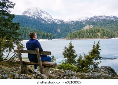 Bautiful landscape. Crno Lake. National park Durmitor and Black Lake. Zhablyak, Montenegro. The man on a bench looks at a landscape