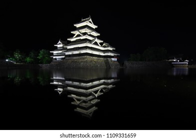 Bautiful reflection in water at night of Matsumoto Castle. It is a Japanese premier historic castles in easthern Honshu, Matsumoto-shi, Chubu region, Nagano Prefecture, Japan. June 9, 2018.