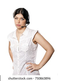 A bautiful young adult Caucasian woman wearing a headset and rolling her eyes up with a displeased expression. Isolated on white background.
