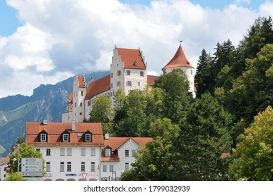 Bavaria, Germany - August 16, 2011: View of houses and the High Castle or Hohes Schloss in the urban center of the city of Fussen