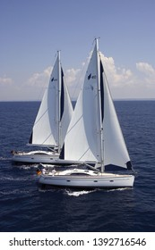 Bavaria, Germany- August 20,2008: two 40 feet Bavaria sail yachts are sailing in deep blue sea, side view
