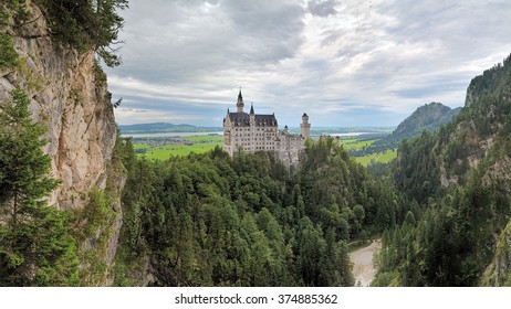 BAVARIA, GERMANY - AUGUST 27, 2010: View of Neuschwanstein Castle from Marie's Bridge in cloudy day. More than 1.3 million people visit the castle annually, with as many as 6,000 per day in the summer