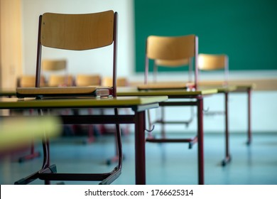 Bavaria, Germany. June 30, 2020. School chairs on desks in an used classroom in a school  as the summer holidays approach. It is hoped to return to normal lessons in September.
