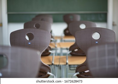 Bavaria, Germany. March 14, 2020. Chairs stacked on school desks in a German school the day after the Department of Education  in Munich closed schools due to the Corona virus.
