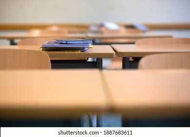 Bavaria, Germany. November 20, 2020. A student's discarded books and folders on a desk in a deserted classroom in Germany as Corona virus continues to close schools