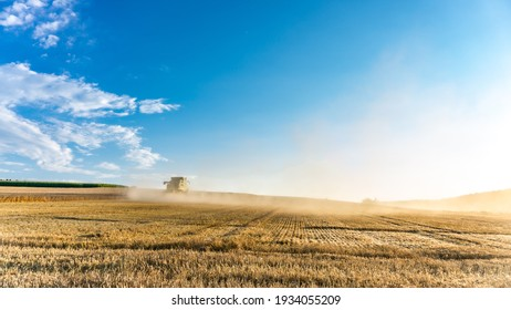Bavaria, Germany-July 2018: View of agricultural wheat field during harvest time with industrial combine machine in working prosses. Countryside crops of Bavarian environment.