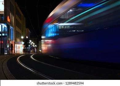 Würzburg, Bavaria/Germany - 01 09 2019: Tram driving through german city at nighttime. Straßenbahn fährt durch Würzburg bei Nacht