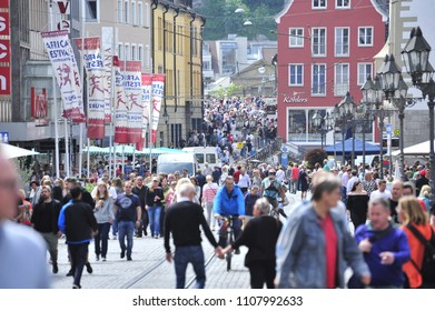 Würzburg, Bavaria/Germany- 05/19/2018: Spectators empty into the streets after the conclusion of the Africa Festival.