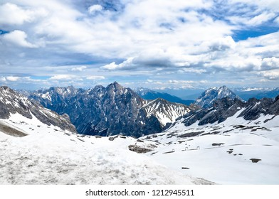Bavarian Alps landscape, view from a Zugspitze, Germany. Beautiful mountains with snow and dramatic cloudscape.