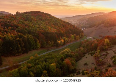 Bavarian Autumn Hill Landscape in Upper Franconia, Germany. Amazing serene red and orange colors of the fall. Romantic quiet mood after Sunset