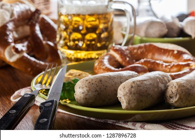 Bavarian breakfast with white sausage, pretzel and beer
