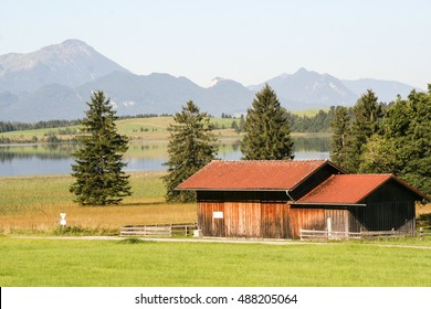 Bavarian farm by an Alpine lake