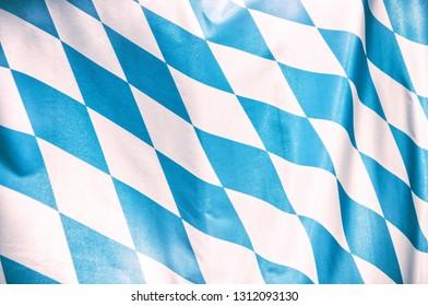 bavarian flag waving in the sun at oktoberfest