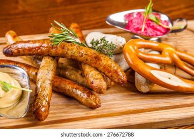 Bavarian fried sausages and pretzel