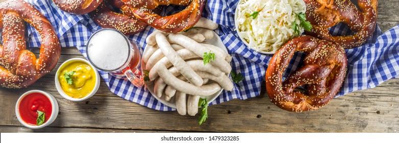 Bavarian German holiday traditions. Oktoberfest food and beer glass mug. Background for congratulations with Oktoberfest, autumn restaurant menu.