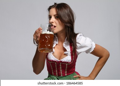 Bavarian girl is drinking beer