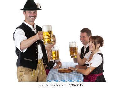 Bavarian man with friends toasts with Oktoberfest beer stein. Isolated on white background.