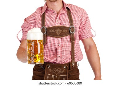 Bavarian man with leather trousers (Lederhose) holds Oktoberfest beer stein. Isolated on white background.