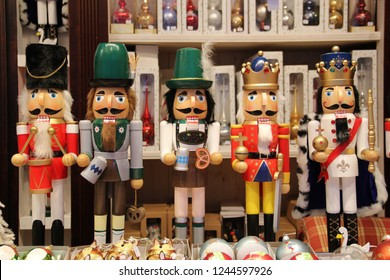 Bavarian nutcrackers and British nutcracker dolls at Christmas market in Munich, Germany. Decorative wooden figurines resemble toy soldiers, kings or oktoberfest locals. Toys or Ore Mountain souvenirs