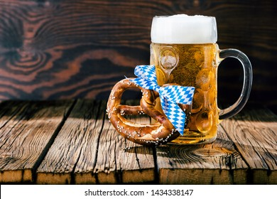 Bavarian Oktoberfest beer and  pretzels on wooden table