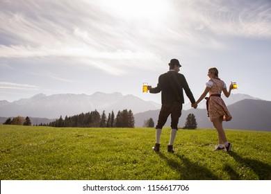 Bavarian People with beer mugs Oktoberfest Germany