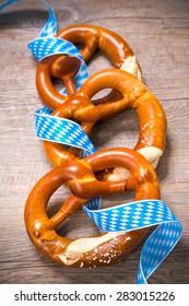 Bavarian Pretzels with ribbon. Oktoberfest background