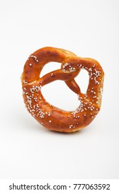 bavarian prezel with salt on white background