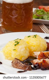 bavarian roast pork with beer and dumplings