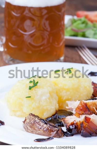 bavarian roast pork with beer and dumplings