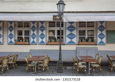 Bavarian street restaurant with windows and blue-white ornaments