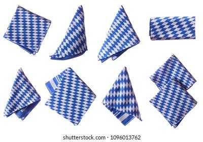 Bavarian white and blue napkin set. Oktoberfest items isolated.
