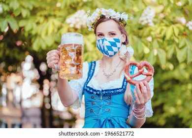 Bavarian woman toasting with beer during covid 19