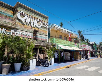 BAVARO, PUNTA CANA, DOMINICAN REPUBLIC - 9 APRIL 2019: Street road at El Cortecito with souvenir shops