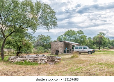 BAVIAANSKLOOF, SOUTH AFRICA - MARCH 5, 2016: Camping in wet conditions at Bo-Kloof in the Baviaanspoort (baboon valley). The ablution facilities and barbecue area are visible