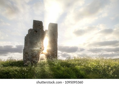 Bawsey church ruin with etherreal sunlight coming through the ancient building. Landscape and cloudscape in a rural location in England