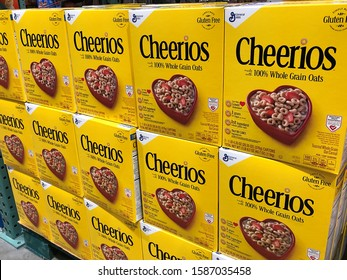 BAXTER, MN - 8 DEC 2019: Cheerios cereal boxes on display in a store. General Mills manufactures and markets branded consumer foods.