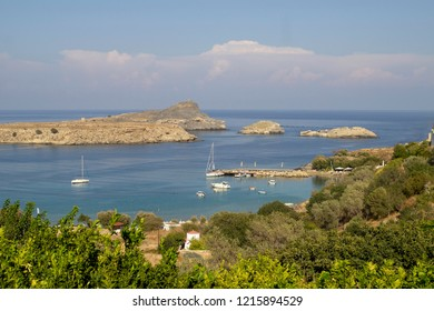 The bay around the village of Lindos, Rhodes Greece, as viewed from one of the many vantage points above the village.Lindos is a very popular tourist destination.