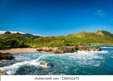Bay with beach in Puerto Plata Dominican Republic with ocean waves